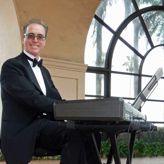 Pianist Kevin Fox, performing for a wedding ceremony on keyboard at the Hilton Santa Barbara Beachfront Resort.